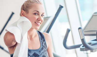 Woman Wiping Sweat After Workout