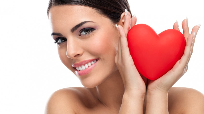 Woman Holding a Heart-Shaped Toy