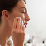 Woman Applying Toner to Face